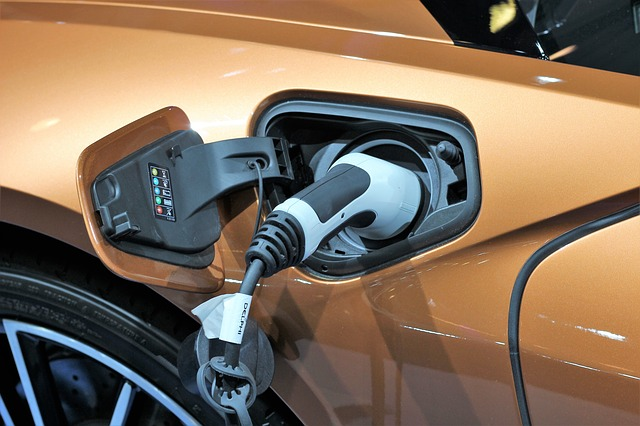 Electric Car Charging cable being used in brown car